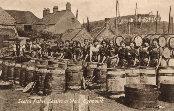 Scotch 'Fisher Lassies' at work - Eyemouth in Berwickshire, in the Scottish Borders. Standing by the herring barrels Date: circa 1907