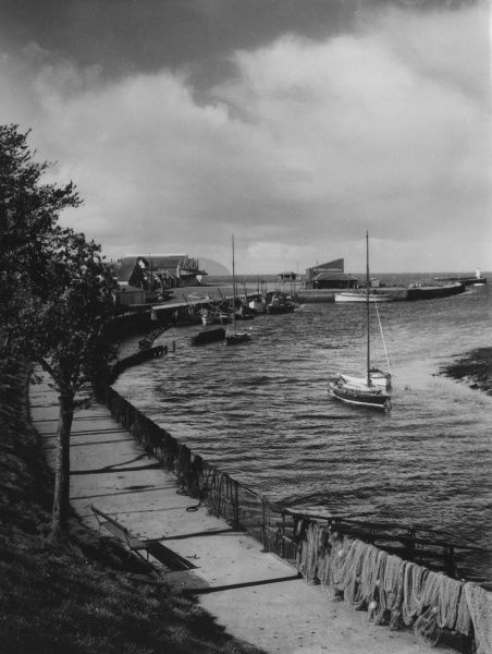 A corner of the harbour at Girvan, Ayrshire, Scotland. Girvan is the centre of a thriving herring fishing industry. Date: 1950s