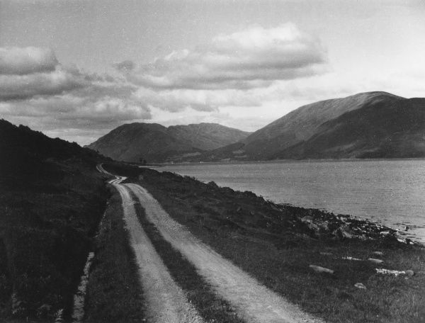 A view of Loch Striven, a sea loch in Argyllshire, Scotland. This little-used road beside the loch ends abruptly after a few miles. Date: 1930s
