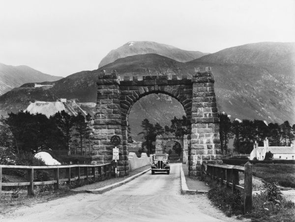 Where the road to Mullaig, 'The Road to the Isles', leaves Fort William, Inverness-shire, Scotland. A glimpse of Lochy Bridge, with Ben Nevis looming above