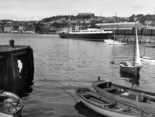 A fine impression of the harbour at Oban, Argyllshire, Scotland, a busy seaport, known as the 'Gateway to the Highlands', Date: 1950s