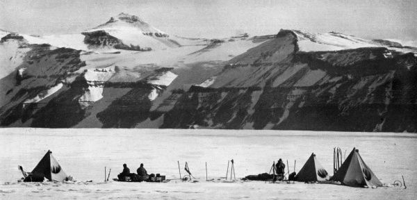 Photograph taken by Captain Scott during the ill-fated polar expedition to the South Pole in 1910 - 1912, showing tents pitched on the way up the Beardmore Glacier, with the Wild Range comprising the Adams, Marshall and Wild mountains with their