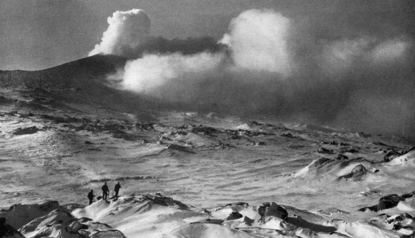 The slopes of Mount Erebus, the active volcano on Ross Island in the Antarctic, shrouded in smoke and cloud, seen during the ill-fated Scott polar expedition to the South Pole, 1910 - 1912