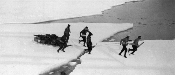 A view showing how sledges were rushed from one ice floe to another, with a sled pulling team waiting for two floes to meet and quickly dashing across