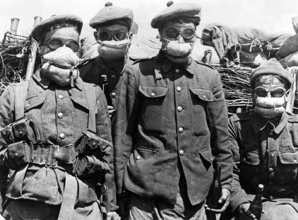 Four soldiers of the 2nd Batallion Argyll and Sutherland Highlanders, 19th Brigade, 6th and 27th Divisions, Bois Grenier Sector, wearing some of the first gas masks to be issued to soldiers in the trenches of the Western Front during the First World War
