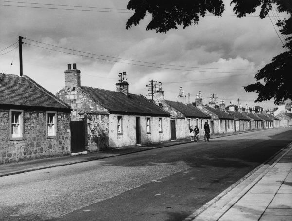 A row of single storey, stone built cottages at Ayr, Ayrshire, Scotland