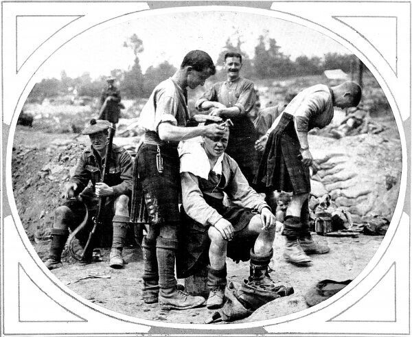 A Scottish army barber is shown cutting another soldier's hair, August 1916
