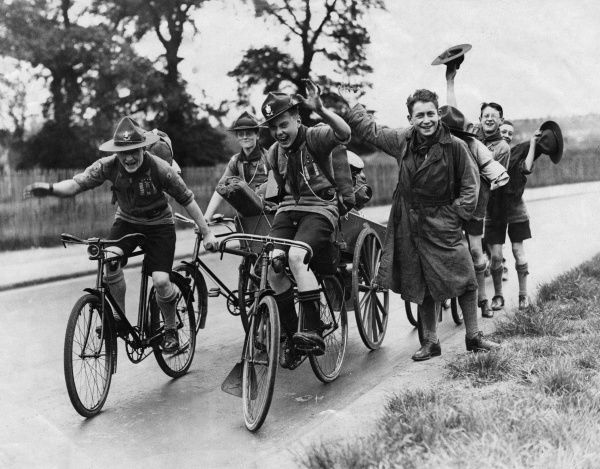 The Happiness of the Road: A batch of happy boy scouts on their return from a weekend camping near Windsor, Berkshire, England. Date: 18 May 1930