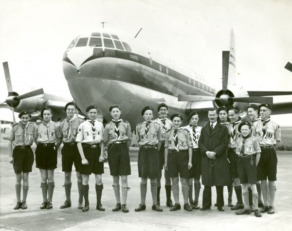 Mr Trevor Scott-Chard and London Air Scouts at London Heathrow Airport with British Overseas Airways Corporation Boeing Stratocruiser 'Canopus' behind them. 1950