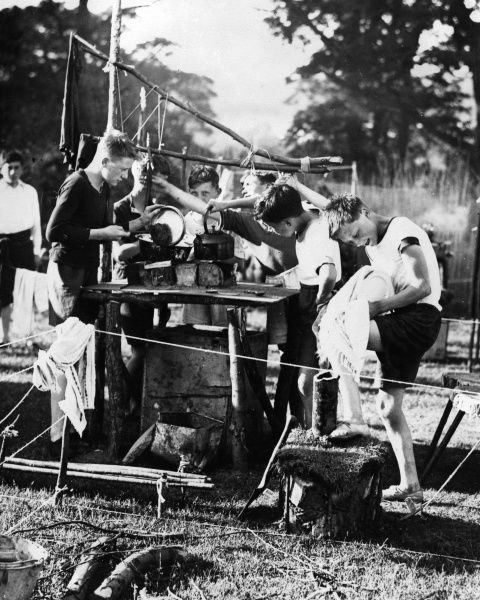 Washing-up is not such a chore for these cubs and scouts, part of a jamboree at Salhouse Broad, Norfolk. 2000 scouts met Prince George (Duke of Kent) and Lord Baden Powell. Date: early 1930s