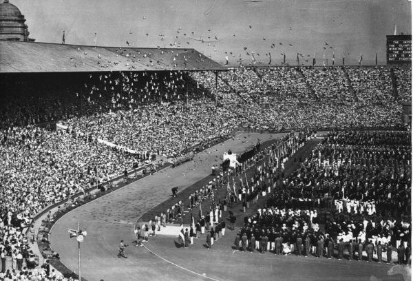Scouts releasing pigeons as part of the opening ceremony of the 1948 London Olympics at Wembley Stadium. 1948