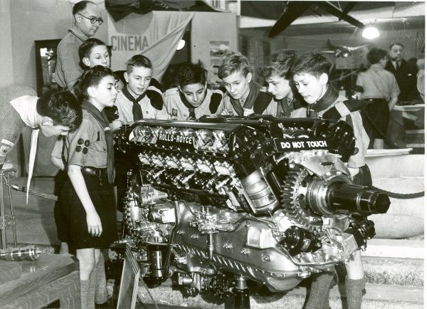 A group of Scouts looking at a Rolls-Royce Merlin engine. 1940s