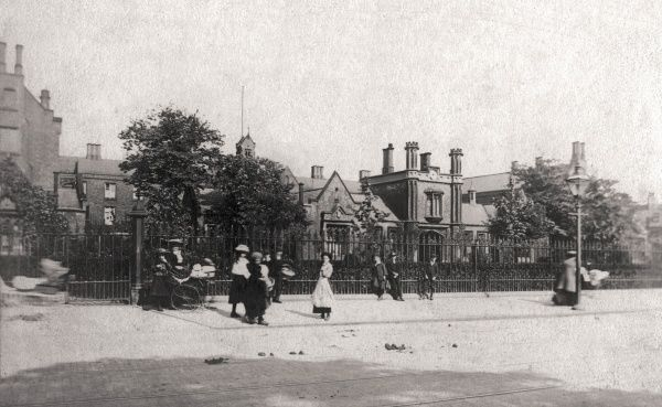 A gaggle of children and several mothers with prams outside the Sculcoates Union workhouse on Beverley Road, Hull. The building was erected in 1843-5 to designs by Henry F Lockwood and William Mawson. It later became the Kingston General Hospital
