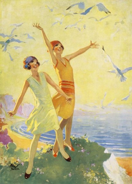 Two flapper girls in typical short dresses and hats of the late 1920s period, have a moment of being at one with nature on a cliff top as they throw out their arms to welcome some seagulls