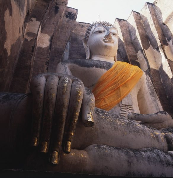 The large seated Buddha in the Wat Si Chum (Temple of the Bodhi Tree) at Old Sukhothai, Thailand. The temple dates from the 13th century