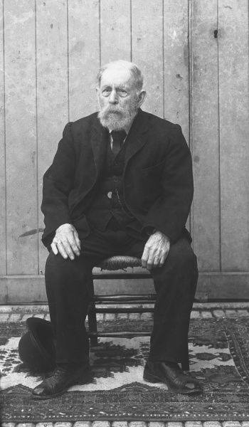 A seated elderly gentleman. Photograph by Ralph Ponsonby Watts