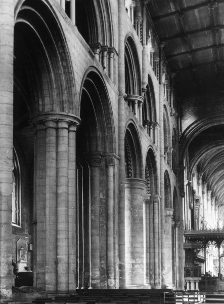 The magnificent Norman nave of Selby Abbey, Yorkshire, England. The tower is also Norman, but the eastern end is decorated Gothic style. Date: founded 1069