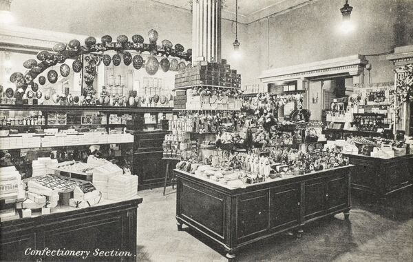 Selfridges & Co, Oxford Street, London - Confectionery Section. Founded by American-born retail magnate Harry Gordon Selfridge (1858 - 1947), the Flagship store in Oxford Street was opened in 1909. Selfridge was an innovator in the fields of marketing