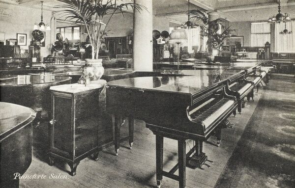 Selfridges & Co, Oxford Street, London - Pianoforte Salon. Founded by American-born retail magnate Harry Gordon Selfridge (1858 - 1947), the Flagship store in Oxford Street was opened in 1909. Selfridge was an innovator in the fields of marketing