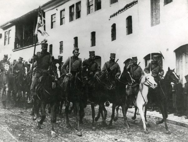 Serbian cavalry riding through a town on the eastern front during the First World War. Date: 1915-1917