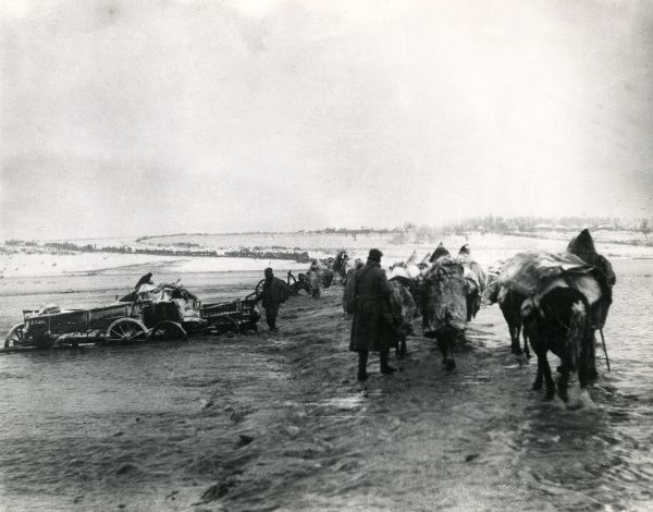 Serbian troops crossing marshes near Scutari during their retreat, First World War. Date: 1914