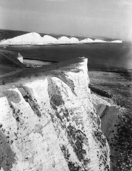Seven Sisters, on the coast of Sussex, England. Found where the South Downs meet the sea, the 'Sisters' were created when the ancient rivers cut valleys into the chalk. Date: 1950s