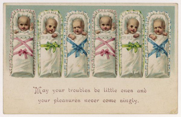 "A delightful row of sextuplets, decorated in pink, green and blue ribbon: ""May your troubles be little ones and your pleasures never come singly.&quot"