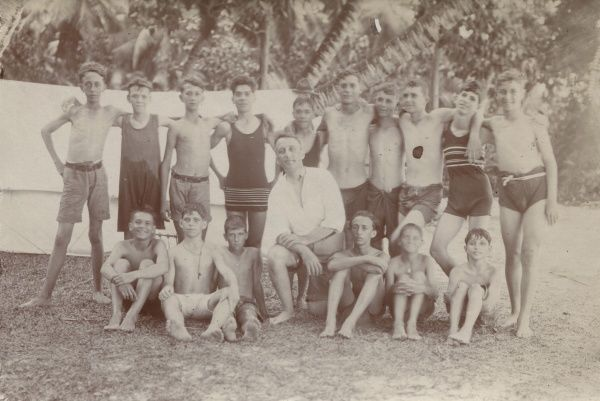 The scouts have two sea baths a day. The Scoutmaster in the centre. August Camp, Seychelles.  circa 1931