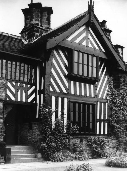 The splendid half-timbered porch of Shibden Hall, near Halifax, Yorkshire, England. Date: 15th century