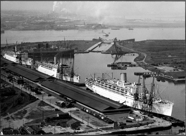 Four P&O ships at Tilbury Docks, London: (from left to right) 'Chitral' (painted black); 'Strathnaver'; 'Strathaird'; 'Himalaya&#39