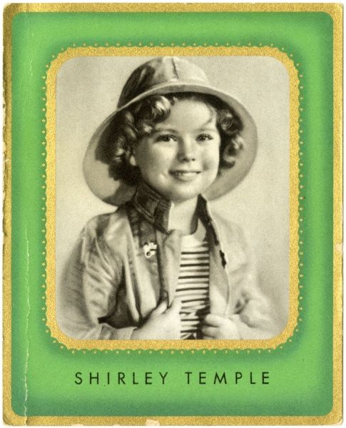 SHIRLEY TEMPLE American child star of the 1930s, seen here in a rainhat
