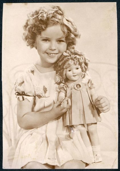 American film actress Shirley Temple, with supposedly look-alike doll