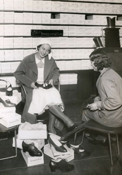 Woman trying new shoes in a shop in Malmo, 1940s. Date: 1940s