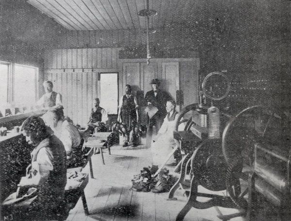 Interior view of shoemakers' workshop at the Holborn Union Workhouse, Mitcham Date: 1905