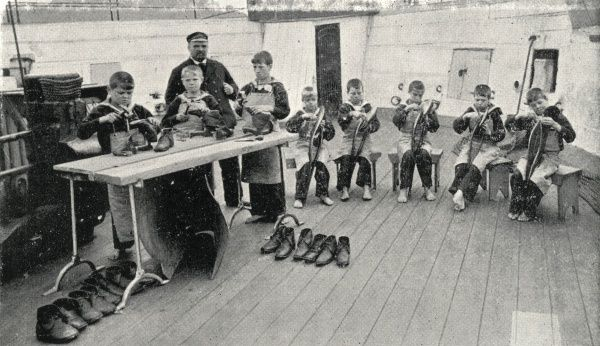 Boys taking part in a shoemaking or repairing class on the Training Ship Wellesley, on the River Tyne at North Shields, Northumberland