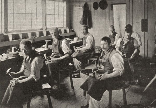 The shoemaking workshop at the Holborn Union workhouse, Mitcham, Surrey. Male inmates are at work making and repairing shoes for use in the workhouse