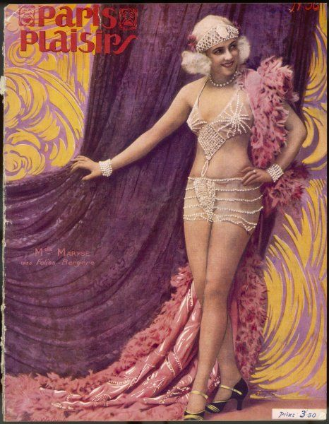 Mademoiselle Maryse of the Folies Bergere in an intriguing dress and headpiece of pearls
