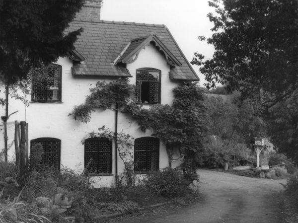 A lovely cottage with lattice windows, at Montford Bridge, Shropshire, England. Date: 19th century