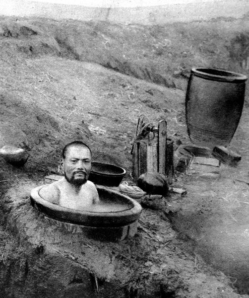 A Japanese soldier taking a bath in an earthenware jar, at the siege of Tsing-Tau