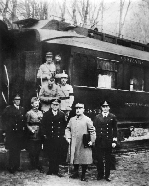 Photograph taken just after the signing of the Armistice which ended the First World War, in a railway carriage in the Compiegne Forest, Picardy, Northern France. Standing outside the carriage are: (1) Marshal Foch, (2) Admiral Sir Rosslyn Wemyss