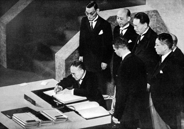 Photograph showing Shigeru Yoshida, the Japanese Premier, signing the Peace Treaty at San Francisco, 4th September 1951