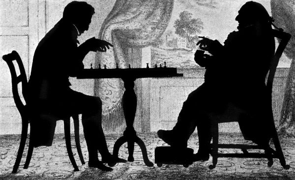 Charming silhouette scene depicting two men playing a game of chess. Date: c.1830