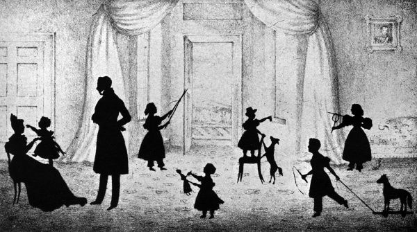 A charming silhouette of a family group a mother and father surrounded by their six children. One plays with a wooden horse on wheels, another with a diabolo, a little girl plays a violin and two more play with a doll and the family dog. Finally