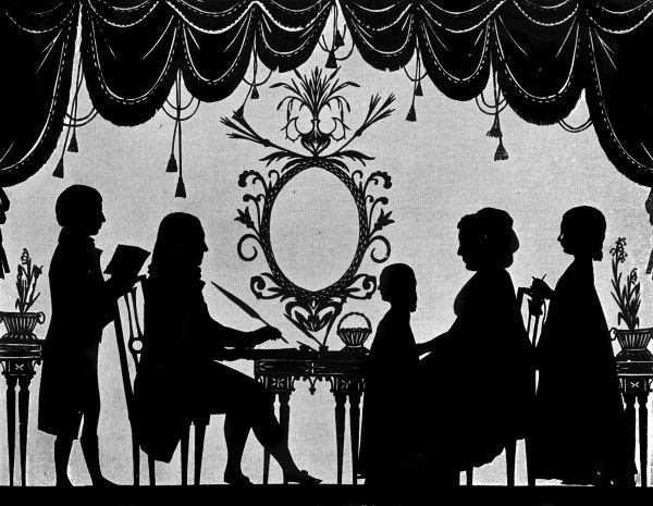 A silhouette portrait of the Burney family (possibly that of the musical historian, Charles Burney?), pictured in a civilised tableaux around a table with swagged curtains framing the scene. Date: c.1780s
