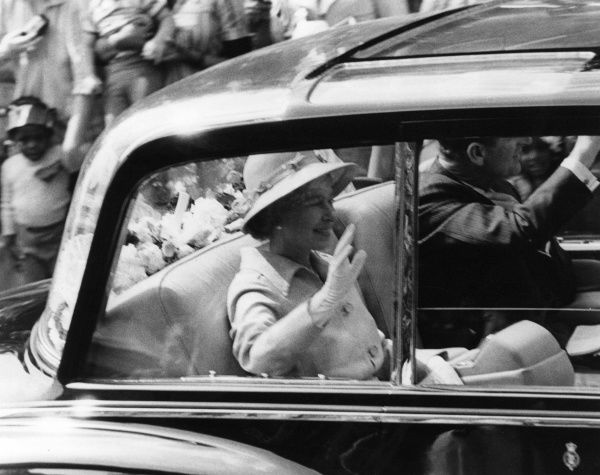 ELIZABETH II with Prince Philip, waving to crowds from a car during the Jubilee celebrations Date: 1977