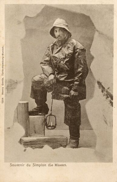 A 'Miner' from the Simplon region of Switzerland. It looks as if he is about to lead a guided tour of a tunnel system cut through glacial ice. Date: circa 1905