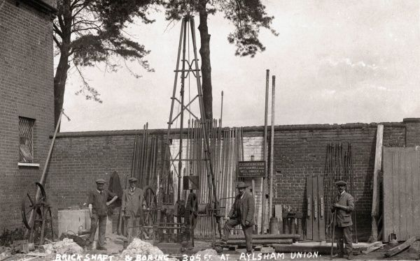 The firm of F.H. Buckingham sinking an artesian well at Aylsham Union workhouse in 1923. The workhouse, designed by William J Donthorn, was erected in 1848-9 at Aylsham. It later became St Michael's Hospital