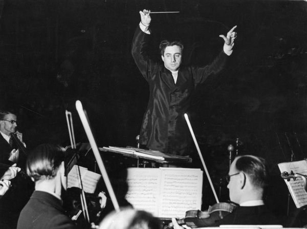 Sir John Barbirolli (1899-1970) English conductor and cellist, here conducting the BBC Symphony Orchestra on February 13th 1944