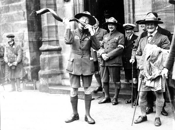 Photograph showing Sir Robert Baden-Powell (1857-1941) (centre), the English soldier and founder of the Boy Scouts, playing the Kudu horn at a Scouts World Jamboree, Birkenhead, July 1929