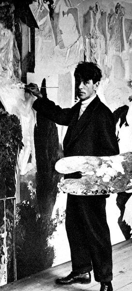 Photograph of Sir Stanley Spencer (1891-1959), the English painter, standing in front of his painting 'The Resurrection', c.1926